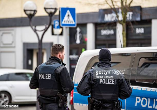 Police officers at the scene outside the Midnight hookah bar one of two bars that were targeted by a gunman last night on February 20 2020 in Hanau...