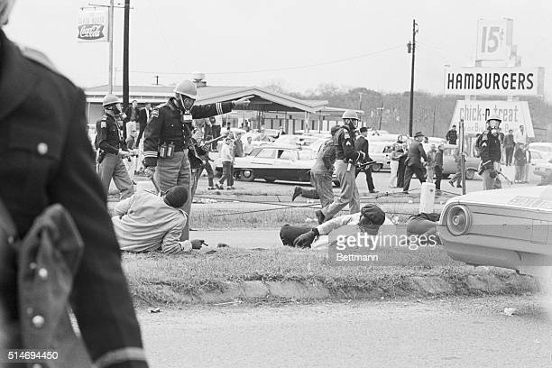 Police officers attack civil rights marchers in Selma Alabama who were attempting to begin a 50 mile march to Montgomery to protest race...