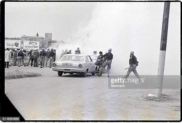 Police officers attack civil rights marchers with tear gas in Selma, Alabama. The marchers were attempting to begin a 50 mile march to Montgomery to...
