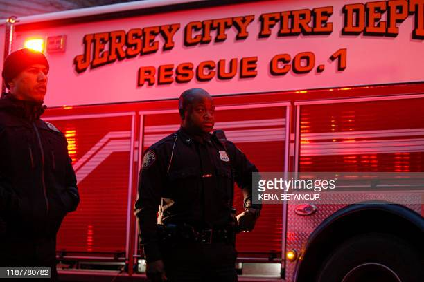 Police officers attend a emergency on the scene where active shooting is happening in Jersey City on December 10 2019 A shooting in a New York suburb...