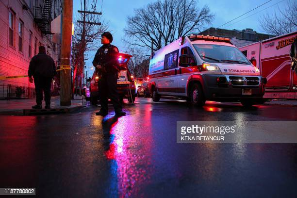 Police officers attend a emergency on the scene where active shooting is happening in Jersey City on December 10, 2019. - A shooting in a New York...