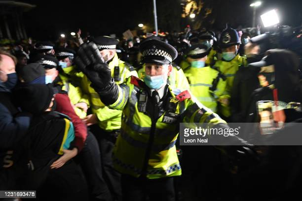 Police officers attend a vigil on Clapham Common, where floral tributes have been placed for Sarah Everard on March 13, 2021 in London, England....