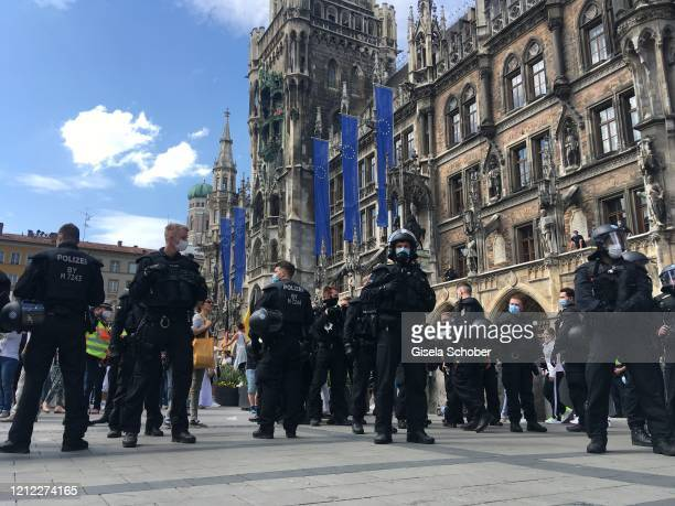 Police officers attend as protesters gather to demand an end to the Coronavirus lockdown measures in front of the city hall at Marienplatz on May 09...