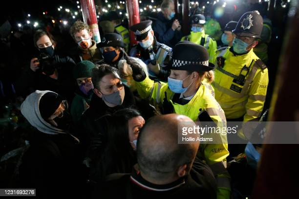 Police officers attend during a vigil for Sarah Everard on Clapham Common on March 13, 2021 in London, United Kingdom. Vigils are being held across...