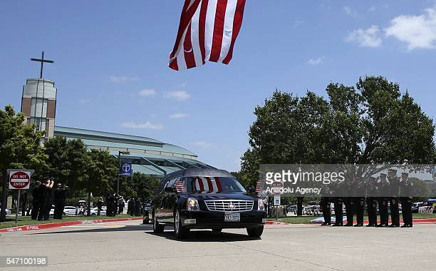 Police officers attend the funeral ceremony of Lorne Ahrens at the Prestonwood church in DallasTexas USA on July 13 2016 Ahrens was one of five...