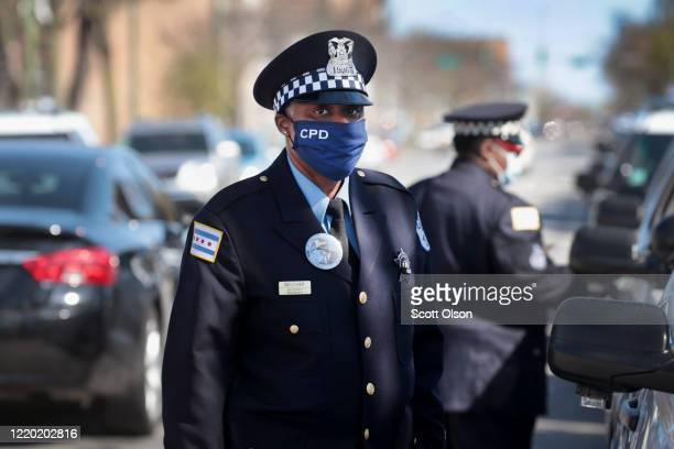 Police officers attend the funeral of Sergeant Clifford Martin, a 25-year veteran of the Chicago Police Department, on April 21, 2020 in Chicago,...