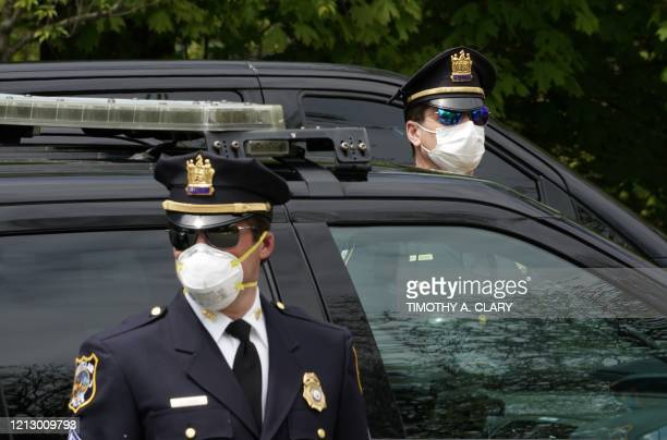 TOPSHOT Police officers attend the outdoor funeral of the late Glen Ridge Police Officer Charles Rob Roberts who died of coronavirus weeks after...