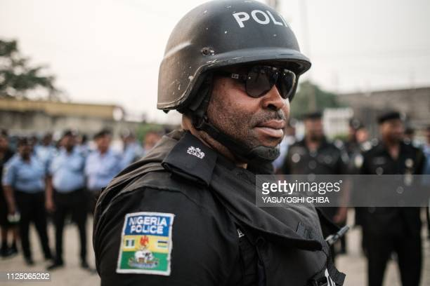 TOPSHOT Police officers attend the posting parade for the election before deploying to polling staions at the central police station in Port Harcourt...