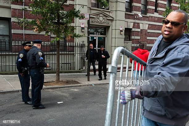 Police officers begin to put down barricades on West 147th Street the street of Dr Craig Spencer the doctor recently diagnosed with Ebola on October...