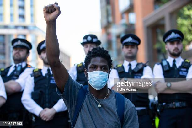 Police officers block a road close to the Embassy of the United States of America as people join in a spontaneous Black Lives Matter march through...