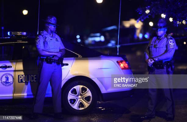 Police officers block access to the Virginia Beach municipal center the site of a mass shooting in Virginia Beach Virginia in the late hours of May...