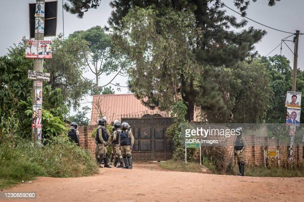 Police officers block anyone from accessing 'Freedom Drive', where the opposition leader Bobi Wine whose real name is Robert Kyagulanyi lives on the...
