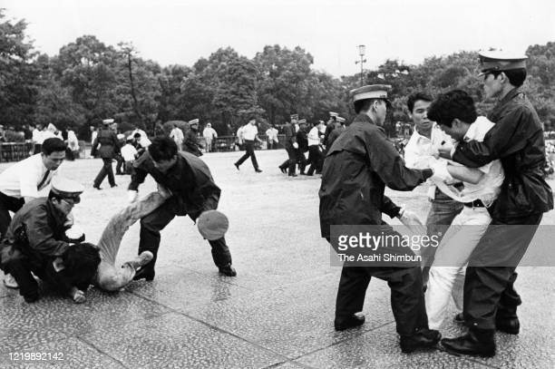 Police officers block men try to attack Prime Minister Eisaku Sato during the Peace Memorial Ceremony on the 26th anniversary of the Hiroshima ABomb...