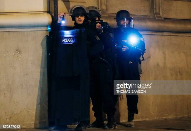 Police officers block the access of a street near the Champs Elysees in Paris after a shooting on April 20 2017 One police officer was killed and...