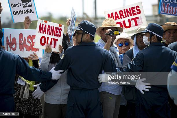Police officers block the road as People stage a rally against past incident of rape of a Japanese woman and drunk driving in Okinawa over American...