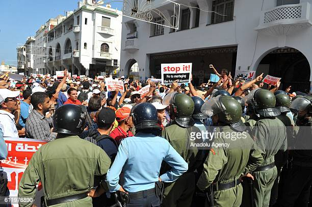 Police officers block the road during a protest against retirement law at Babul Ahad square in Rabat Morocco on October 2 2016