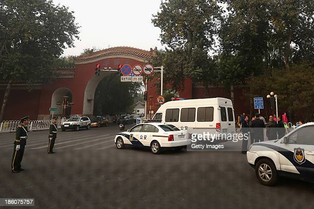 Police officers block the sidewalk toward Tiananmen Square at the Nanchizi crossroad on October 28 2013 in Beijing China Reports by Chinese state...