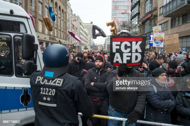 Police officers block the street in front of counterprotestors during a demonstration a 'women's march' coming from the Alternative for Germany's...