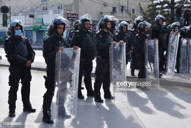 Police officers blocking the road during the demonstration. Close to the Parliament demonstrators protested against the strategy of police repression...