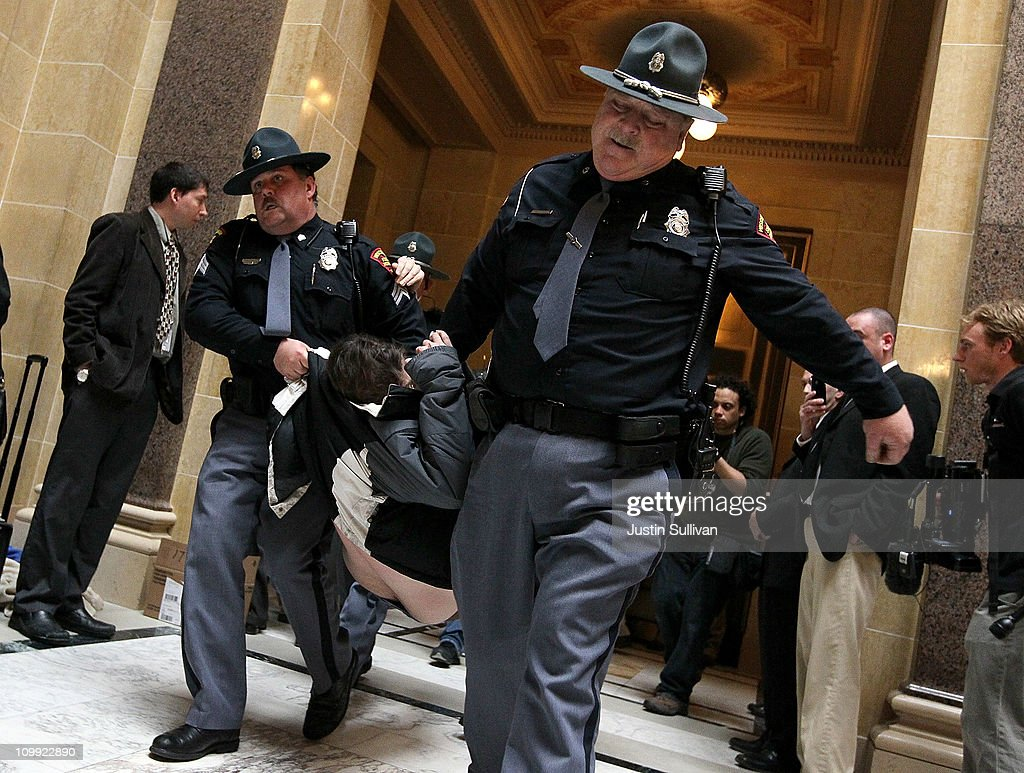 Police officers carry a protestor out of the assembly chamber at the Wisconsin State Capitol on March 10, 2011 in Madison, Wisconsin. Thousands of demonstrators continue to protest at the Wisconsin State Capitol as the Wisconsin house prepares to vote on the state's controversial budget bill one day after Wisconsin Republican Senators voted to curb collective bargaining rights for public union workers in a surprise vote with no Democrats present.