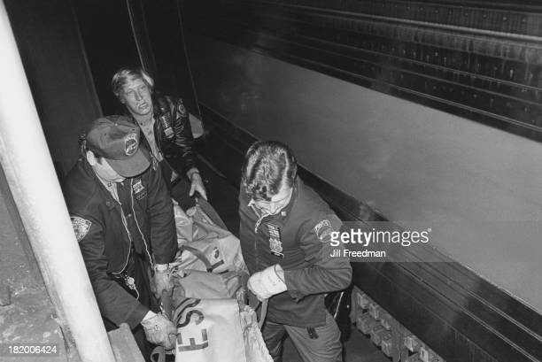 Police officers carry the body of a homeless man from the police station to a morgue in the Lower East Side New York City 1978 The man who had been...