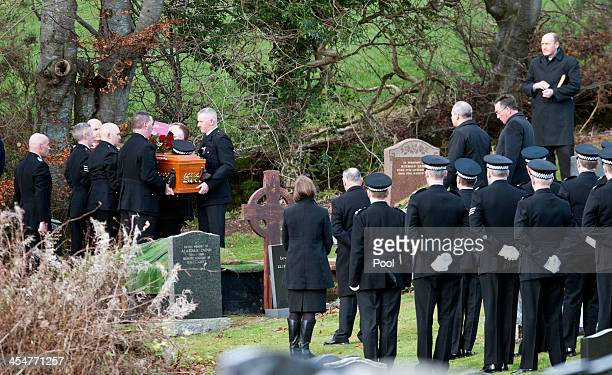 Police officers carry the coffin of colleague and victim of the Clutha Vaults tradegy Constable Tony Collins during his funeral at Lamlash cemetery...
