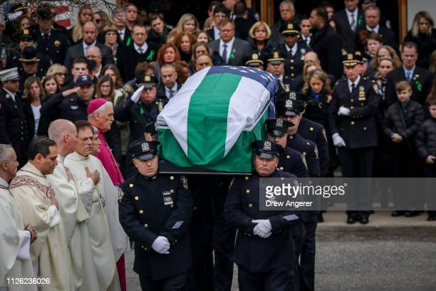 Police officers carry the remains of fallen NYPD Detective Brian Simonsen toward a Hearse following his funeral service at the Church of St Rosalie...
