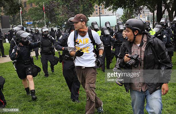 Police officers charge a crowd of demonstrators protesting the G8/G20 summits in Queen's Park June 26 2010 in Toronto Canada The protestors were...