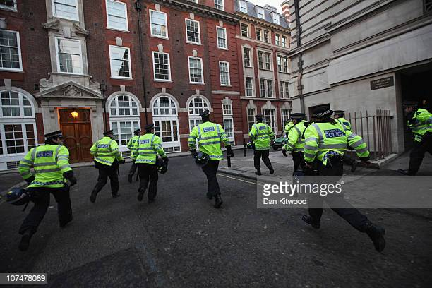Police officers chase student protesters through the streets on December 9 2010 in London England Parliament is voting today on whether to implement...