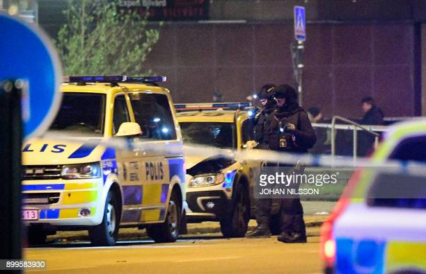 Police officers check a police car parked outside a police station that was said to be damaged by an explosion on December 29 2017 in Malmo Sweden as...