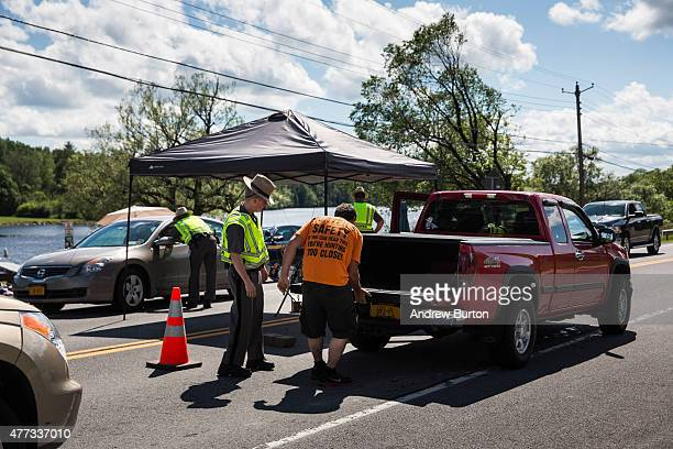 Police officers check automobiles for two escaped convicts at a mandatory check point June 16, 2015 outside Dannemora, New York. A manhunt has been...