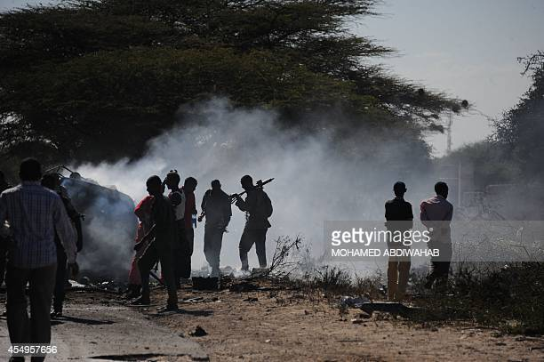 Police officers check the area where a suicide bomber from Somalia's Shebab insurgents killed at least 12 people and wounded 27 others on September 8...