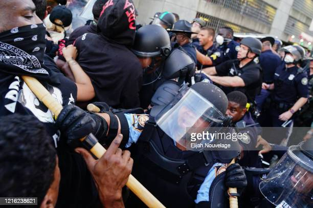 Police officers clash with protesters during a demonstration over the Minneapolis death of George Floyd while in police custody on May 29, 2020 in...