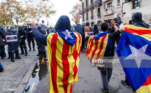 Police officers clash with the protesters during a pro independence for Catalonia protest Demonstrators gathered to try and block Spain's Council of...