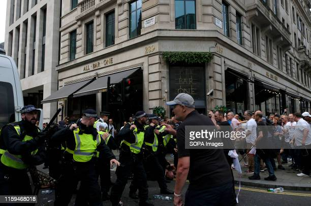 Police officers clash with the supporters of Stephen YaxleyLennon aka Tommy Robinson during the rally in London Supporters gathered outside BBC to...