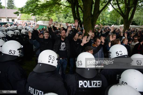 Police officers clear a camp at a park in the Altona quarter in Hamburg Germany 04 July 2017 Under the protest of hundrest of people the police...