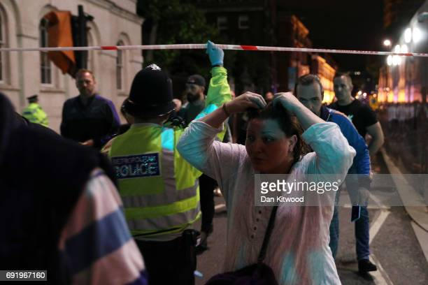 Police officers clear the area near Borough market at London Bridge on June 3 2017 in London England Police have responded to reports of a van...
