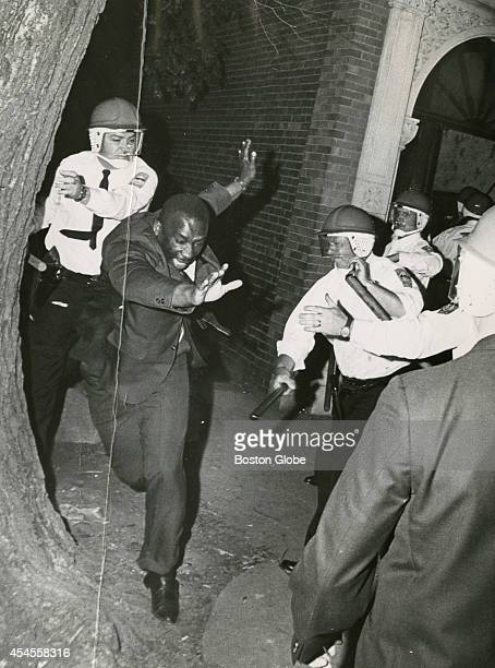Police officers close in on a rioter during a riot in Roxbury in Boston on June 2, 1967. Riots broke out across the neighborhood in response to a...