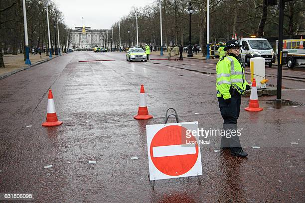 Police officers close the Mall ahead of the Changing of the Guard at Buckingham Palace on January 16 2017 in London England Following a number of...