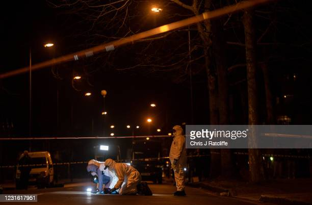 Police officers conduct a fingertip search of Poynders Road outside Poynders Court as they continue the search for Sarah Everard on March 9, 2021 in...