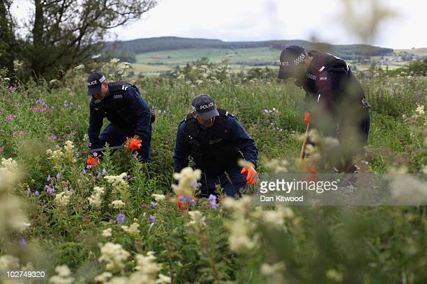 Police officers conduct a search in bushes as part of the ongoing search for Raoul Moat on July 9, 2010 in Rothbury, England. Police continue to...
