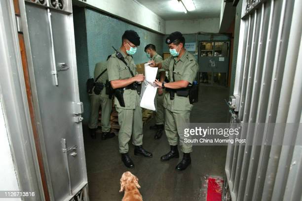 Police officers conduct door-to-door visits to Mei On Industrial Building on Kung Yip Street during an anti-burglary campaign in Kwai chung, where...