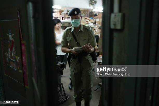 Police officers conduct doortodoor visits to Mei On Industrial Building on Kung Yip Street during an antiburglary campaign in Kwai chung where the...