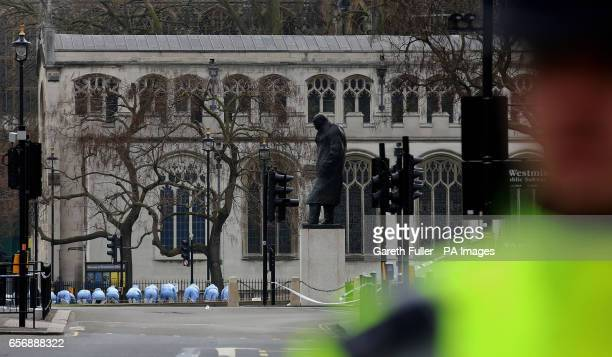 Police officers conducting a fingertip search on Parliament Square near to the Houses of Parliament in London after seven people were arrested in...