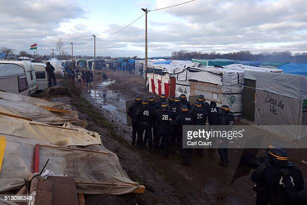 Police officers confront migrants and activists as part of the 'jungle' migrant camp is cleared on February 29 2016 in Calais France The French...