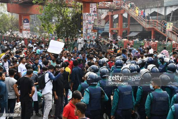Police officers confront protesters at Dhakas Science lab intersection road during the demonstration. Thousands of students from seven colleges and...