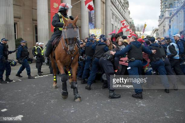 Police officers contain protesters marching to Whitehall during the demonstration against the 'Brexit Betrayal March' Thousands of people took to the...