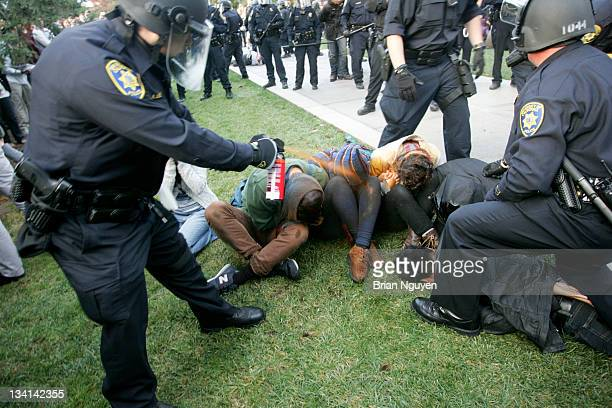 Police officers continue pepper spraying students while breaking up the human chain.