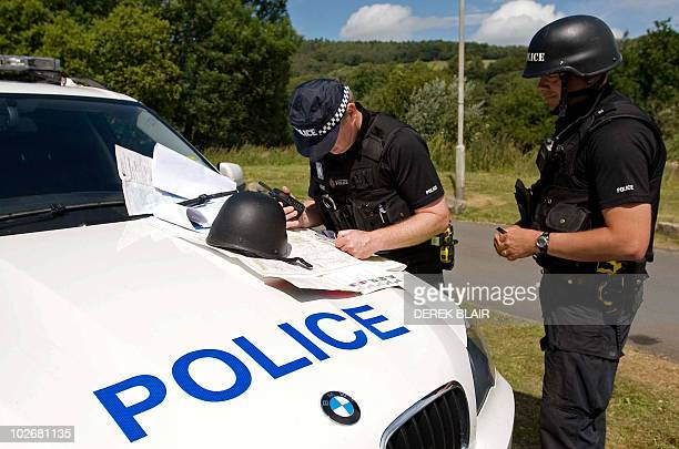 Police officers continue their search for Raoul Moat, on the hills surrounding Rothbury, in northeast England on July 7, 2010. British police offered...