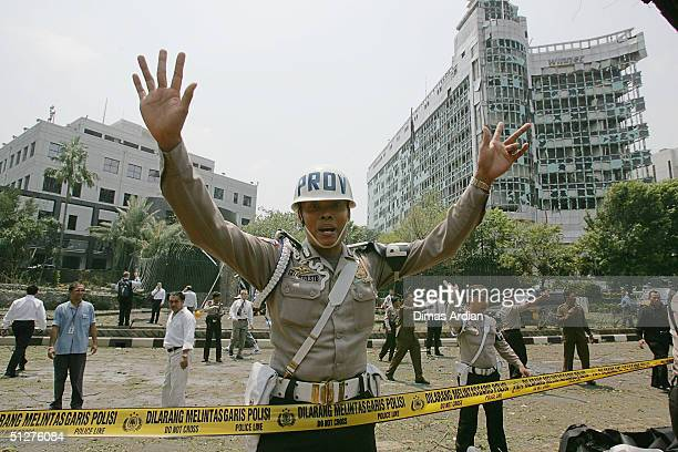 Police officers control crowds outside the Australian Embassy following a bomb blast Thursday Sept 9 in Jakarta Indonesia A powerful explosion in...